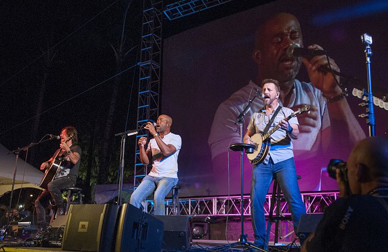 Country music singer Darius Rucker, center, entertains the crowd attending the seventh annual Sunset on the Beach event, where thousands of Oahu residents and visitors gathered in Waikiki to watch the season seven premiere of Hawaii Five-0, titled Makaukau 'oe e pa 'ani, on Friday, Sept. 23, 2016, in Honolulu. Photo: Norman Shapiro/CBS © 2016 CBS Broadcasting, Inc. All Rights Reserved