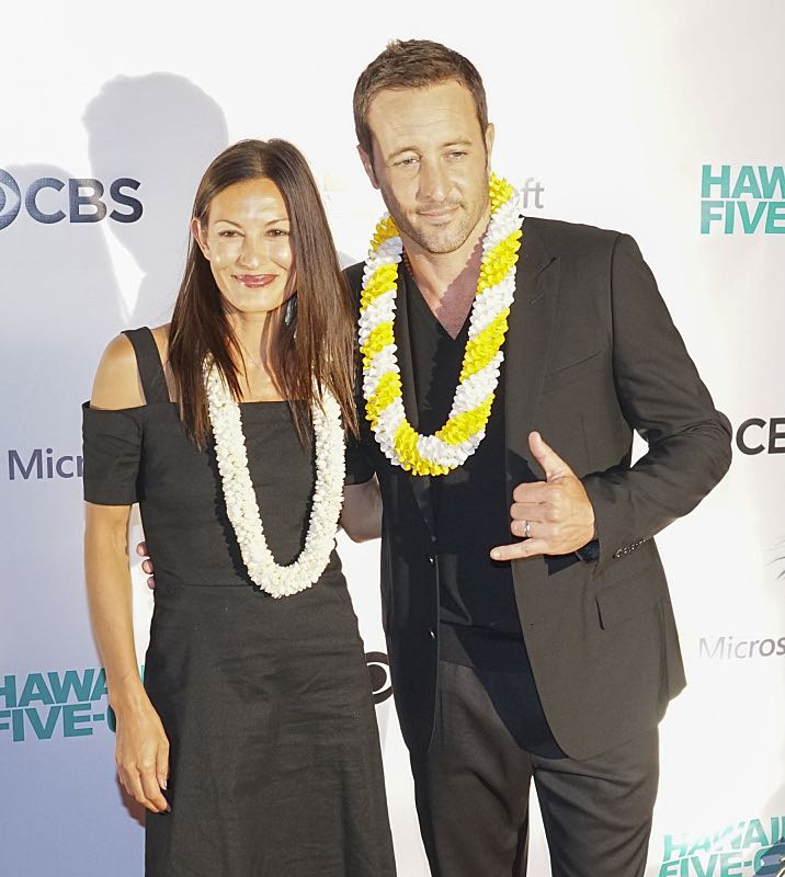 Alex O'Loughlin with his partner Malia Jones pose for pictures on the red carpet at the seventh annual Sunset on the Beach event, where thousands of Oahu residents and visitors gathered in Waikiki to watch the season seven premiere of Hawaii Five-0, titled Makaukau 'oe e pa 'ani, on Friday, Sept. 23, 2016, in Honolulu. Photo: Hugh Gentry/CBS © 2016 CBS Broadcasting, Inc. All Rights Reserved