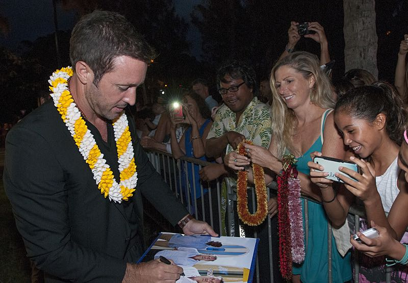 """Alex O'Loughlin who plays the part of """"Steve McGarrett"""" signs a autograph for a fans on the red carpet at the seventh annual Sunset on the Beach event, where thousands of Oahu residents and visitors gathered in Waikiki to watch the season seven premiere of Hawaii Five-0, titled Makaukau 'oe e pa 'ani, on Friday, Sept. 23, 2016, in Honolulu. Photo: Norman Shapiro/CBS © 2016 CBS Broadcasting, Inc. All Rights Reserved"""