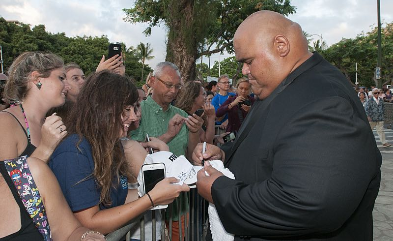 """Taylor Wily who plays the character """"Kamekona"""" signs a autograph on the red carpet at the seventh annual Sunset on the Beach event, where thousands of Oahu residents and visitors gathered in Waikiki to watch the season seven premiere of Hawaii Five-0, titled Makaukau 'oe e pa 'ani, on Friday, Sept. 23, 2016, in Honolulu. Photo: Norman Shapiro/CBS © 2016 CBS Broadcasting, Inc. All Rights Reserved"""