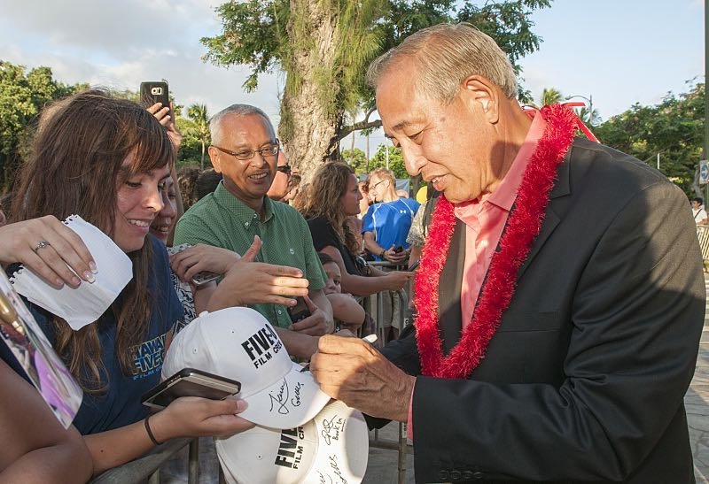 """Dennis Chun who plays the character """"Sgt. Duke Lukela"""" signs a autograph for a fan on the red carpet at the seventh annual Sunset on the Beach event, where thousands of Oahu residents and visitors gathered in Waikiki to watch the season seven premiere of Hawaii Five-0, titled Makaukau 'oe e pa 'ani, on Friday, Sept. 23, 2016, in Honolulu. Photo: Norman Shapiro/CBS © 2016 CBS Broadcasting, Inc. All Rights Reserved"""