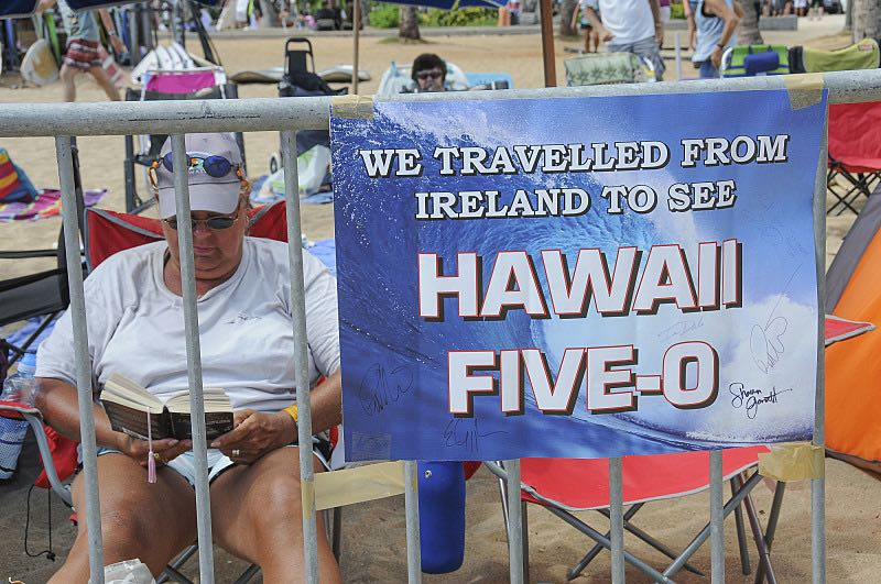 One of many Hawaii Five-0 fans saving their place on Waikiki Beach for the seventh season Sunset on the Beach event, where thousands of Oahu residents and visitors gathered in Waikiki to watch the season seven premiere of Hawaii Five-0, titled Makaukau 'oe e pa 'ani, on Friday, Sept. 23, 2016, in Honolulu. Photo: Norman Shapiro/CBS © 2016 CBS Broadcasting, Inc. All Rights Reserved