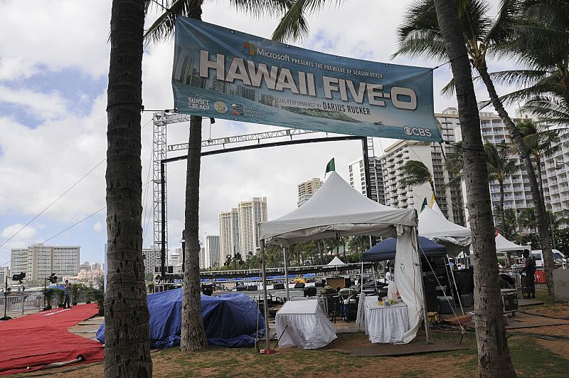 Stage hands work to finish setting up for the seventh annual Sunset on the Beach event, where thousands of Oahu residents and visitors gathered in Waikiki to watch the season seven premiere of Hawaii Five-0, titled Makaukau 'oe e pa 'ani, on Friday, Sept. 23, 2016, in Honolulu. Photo: Norman Shapiro/CBS © 2016 CBS Broadcasting, Inc. All Rights Reserved