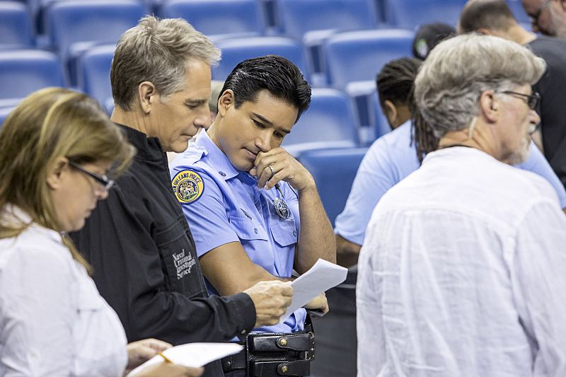 """""""Man on Fire"""" -- After a decorated petty officer is found dead inside a sports arena, evidence leads Pride and the NCIS team to a kidnapping case of a petty officer who was last seen in Mexico, on NCIS: NEW ORLEANS, Tuesday, Oct. 11 (10:00-11:00 PM, ET/PT), on the CBS Television Network. Pictured L-R: Behind the scenes with Scott Bakula and Mario Lopez Photo: Skip Bolen/CBS ©2016 CBS Broadcasting, Inc. All Rights Reserved"""