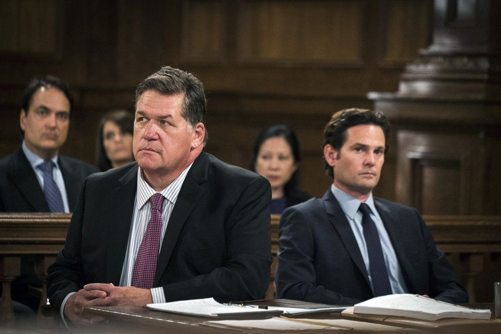 """LAW & ORDER: SPECIAL VICTIMS UNIT -- """"Making A Rapist"""" Episode 1802 -- Pictured: (l-r) Delaney Williams as Counselor John Buchanan, Henry Thomas as Sean Roberts -- (Photo by: Michael Parmelee/NBC)"""