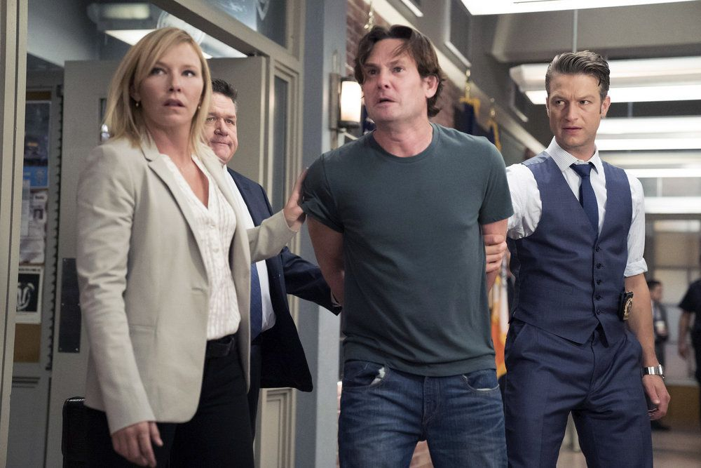 """LAW & ORDER: SPECIAL VICTIMS UNIT -- """"Making A Rapist"""" Episode 1802 -- Pictured: (l-r) Kelli Giddish as Amanda Rollins, Henry Thomas as Sean Roberts, Peter Scanavino as Dominick """"Sonny"""" Carisi -- (Photo by: Peter Kramer/NBC)"""