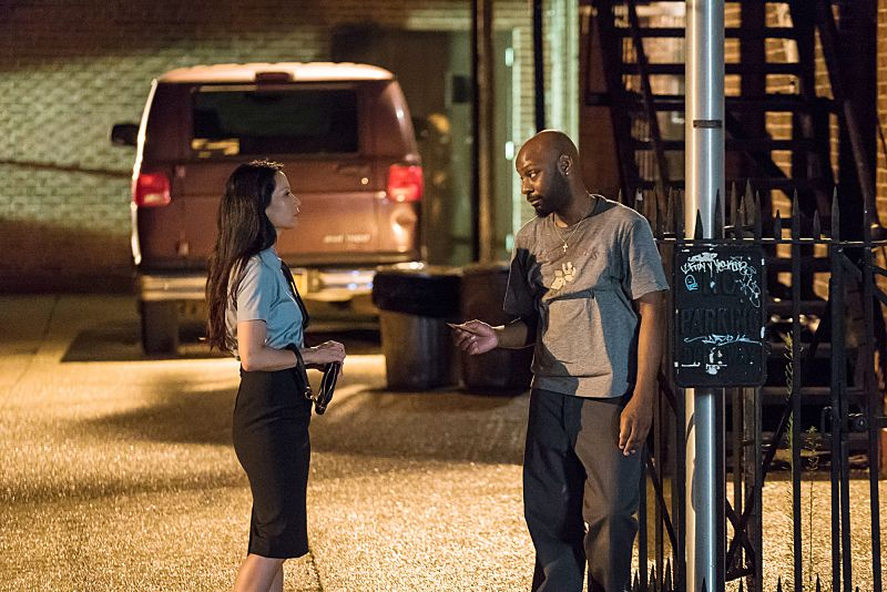 """""""Folie a Deux"""" -- When a serial bomber becomes active again after being dormant for six years, Watson seeks help from Shinwell Johnson (Nelsan Ellis), a former patient whose life she saved when she was a surgeon. Also, Holmes senses Watson is unhappy and questions whether she is still fulfilled by her detective career, on the fifth season premiere of ELEMENTARY, Sunday, Oct. 2 (10:00-11:00, ET/PT), on the CBS Television Network. Pictured (L-R) Lucy Liu as Joan Watson and Nelsan Ellis as Shinwell Johnson  Photo: Michael Parmelee/CBS ©2016 CBS Broadcasting, Inc. All Rights Reserved"""