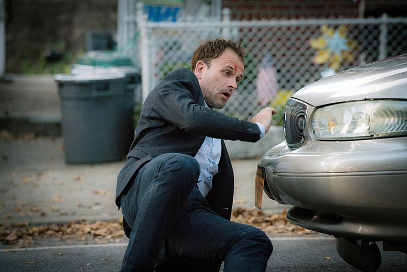 """""""Folie a Deux"""" -- When a serial bomber becomes active again after being dormant for six years, Watson seeks help from Shinwell Johnson (Nelsan Ellis), a former patient whose life she saved when she was a surgeon. Also, Holmes senses Watson is unhappy and questions whether she is still fulfilled by her detective career, on the fifth season premiere of ELEMENTARY, Sunday, Oct. 2 (10:00-11:00, ET/PT), on the CBS Television Network.  Pictured  Jonny Lee Miller as Sherlock Holmes Photo: Michael Parmelee/CBS ©2016 CBS Broadcasting, Inc. All Rights Reserved"""