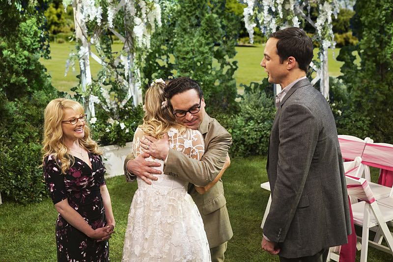 """The Conjugal Conjecture"" -- Pictured: Bernadette (Melissa Rauch), Penny (Kaley Cuoco), Leonard Hofstadter (Johnny Galecki) and Sheldon Cooper (Jim Parsons). After Sheldon's mother and Leonard's father share an evening together, everyone deals with an awkward morning the next day. Also, Penny's family arrives for the wedding ceremony, including her anxiety-ridden mother, Susan (Katey Sagal), and her drug dealing brother, Randall (Jack McBrayer), on the 10th season premiere of THE BIG BANG THEORY, Monday, Sept. 19 (8:00-8:30 PM, ET/PT), on the CBS Television Network. Dean Norris guest stars as Colonel Williams, an Air Force Representative from the Department of Materiel Command. Christine Baranski, Laurie Metcalf, Judd Hirsch and Keith Carradine return. Photo: Monty Brinton/Warner Bros. Entertainment Inc. © 2016 WBEI. All rights reserved."