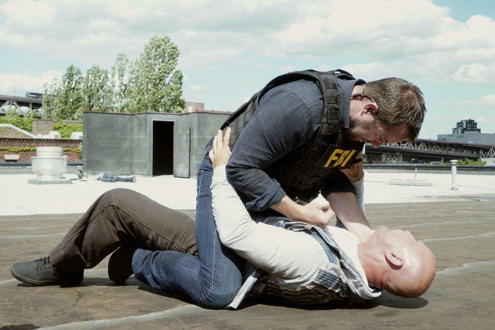 "BLINDSPOT -- ""Heave Fiery Knot"" Episode 202 -- Pictured: (l-r) Sullivan Stapleton as Kurt Weller, Chazz Menendez as Cartel Thug #5 -- (Photo by: Nicole Rivelli/NBC)"