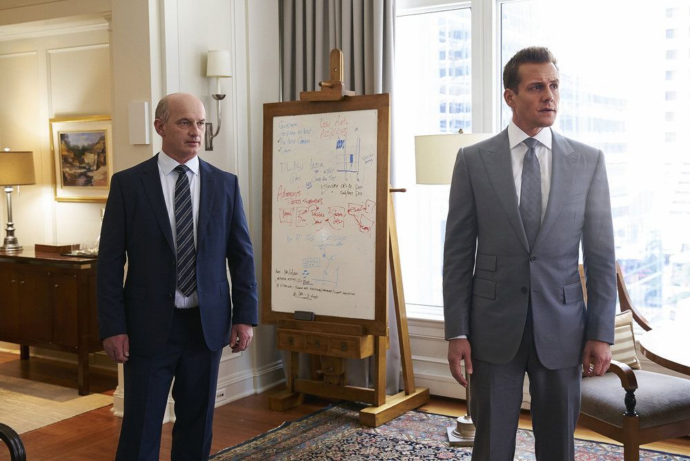 "SUITS -- ""P.S.L."" Episode 610 -- Pictured: (l-r) Gabriel Macht as Harvey Specter -- (Photo by: Shane Mahood/USA Network)"