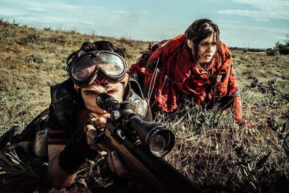 "Z NATION -- ""No Mercy"" Episode 301-302 -- Pictured: (l-r) Nat Zang as 10K, Natalie Taye as Red -- (Photo by: Daniel Sawyer Schaefer/Go2 Z/Syfy)"