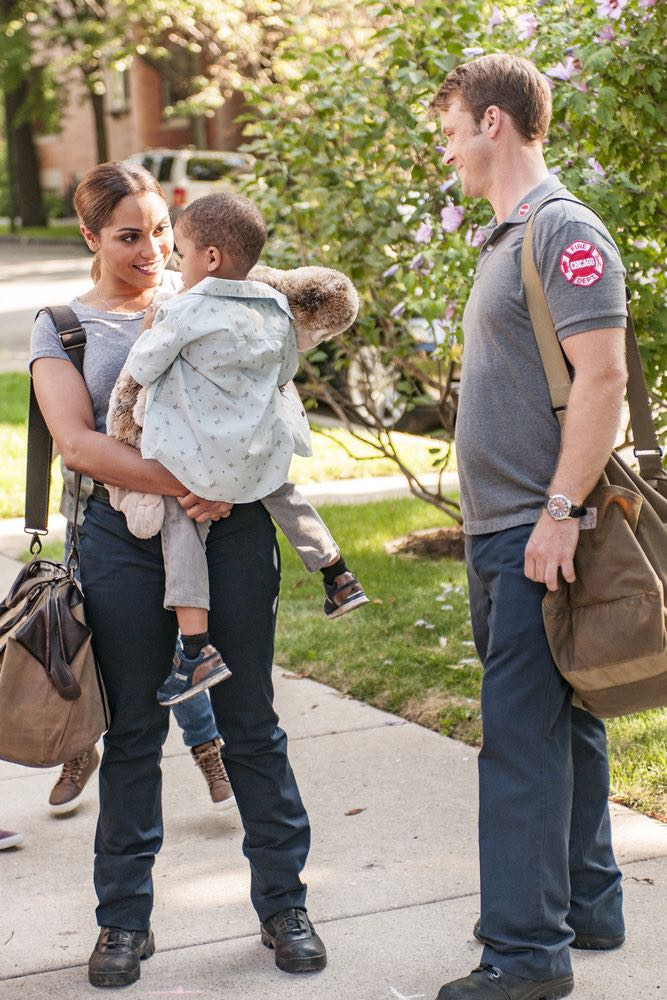 """CHICAGO FIRE -- """"The Hose or The Animal"""" Episode 501 -- Pictured: (l-r) Monica Raymund as Dawson, Aiden/Austin Cohen as Louie, Jesse Spencer as Casey -- (Photo by: Matt Dinerstein/NBC)"""