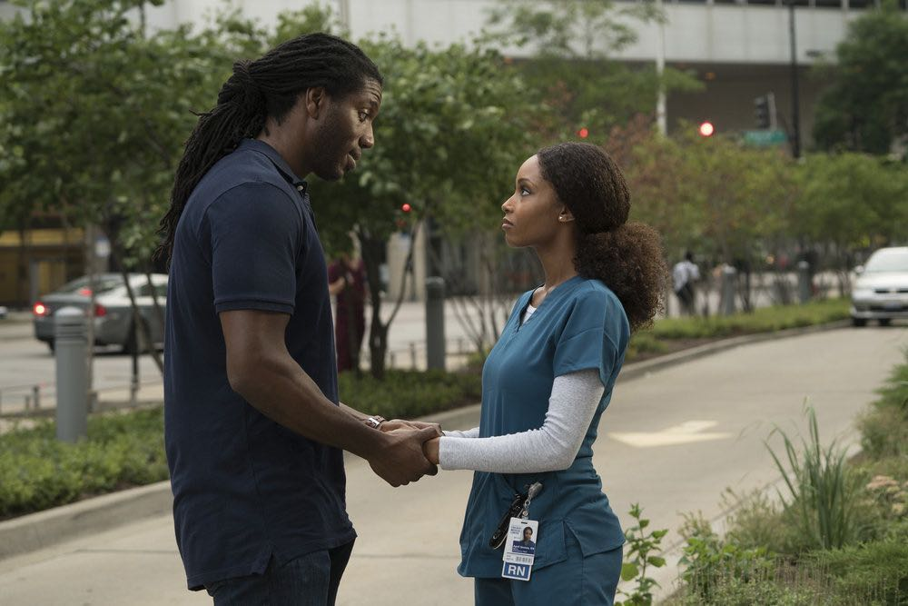 """CHICAGO MED -- """"Soul Care"""" Episode 201 -- Pictured: (l-r) Deron J. Powell as Tate Jenkins, Yaya DaCosta as April Sexton -- (Photo by: Elizabeth Sisson/NBC)"""