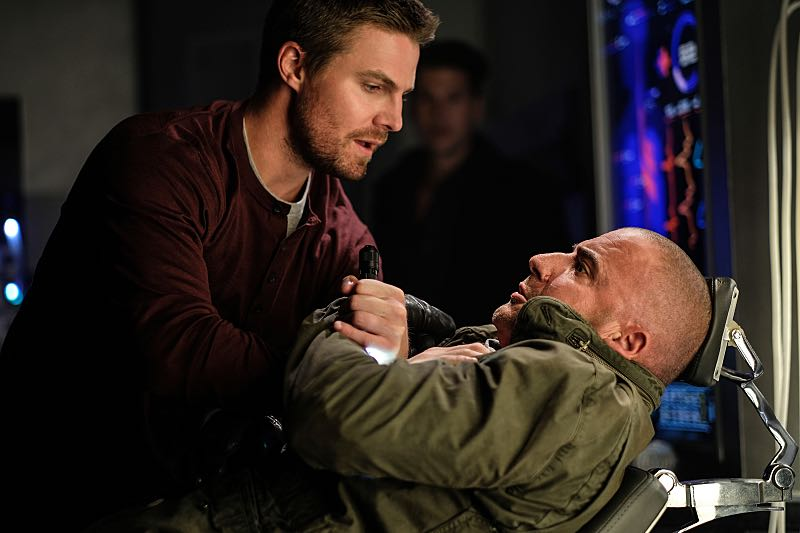 """DC's Legends of Tomorrow --""""Out Of Time""""-- Image LGN201b_0023.jpg Pictured (L-R): Stephen Amell as Oliver Queen and Dominic Purcell as Mick Rory/Heat Wave -- Photo: Robert Falconer/The CW -- © 2016 The CW Network, LLC. All Rights Reserved."""