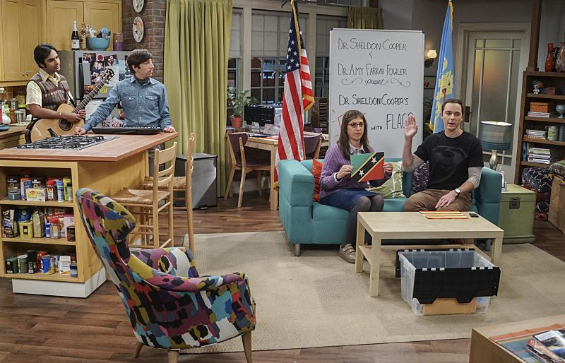 """The Veracity Elasticity"""" -- Pictured: Ken McNickle, Howard Wolowitz (Simon Helberg), Amy Farrah Fowler (Mayim Bialik) and Sheldon Cooper (Jim Parsons). In order to continue living with Sheldon, Amy lies to him about repairs being made to her apartment and they host an """"on location"""" episode of """"Fun With Flags"""" in Penny's apartment. Also, Leonard lets Penny decorate Sheldon's old room after he learns that she has been secretly moving Leonard's collectibles into storage, on THE BIG BANG THEORY, Thursday, Nov. 3 (8:00-8:31 PM, ET/PT), on the CBS Television Network. Photo: Monty Brinton/CBS ©2016 CBS Broadcasting, Inc. All Rights Reserved."""