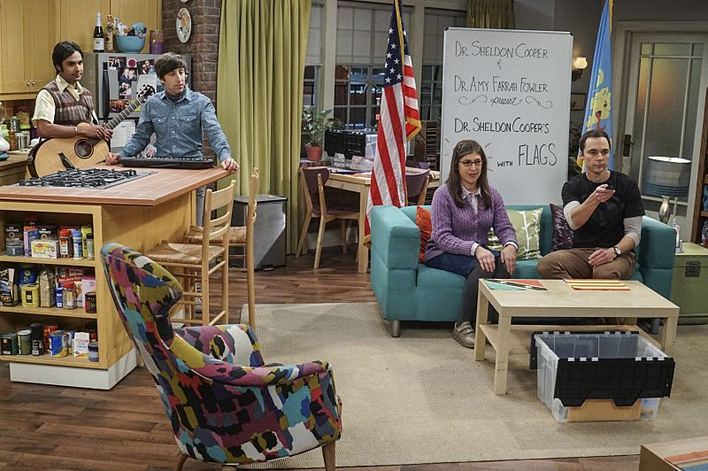 """The Veracity Elasticity"""" -- Pictured: Rajesh Koothrappali (Kunal Nayyar), Howard Wolowitz (Simon Helberg), Amy Farrah Fowler (Mayim Bialik) and Sheldon Cooper (Jim Parsons). In order to continue living with Sheldon, Amy lies to him about repairs being made to her apartment and they host an """"on location"""" episode of """"Fun With Flags"""" in Penny's apartment. Also, Leonard lets Penny decorate Sheldon's old room after he learns that she has been secretly moving Leonard's collectibles into storage, on THE BIG BANG THEORY, Thursday, Nov. 3 (8:00-8:31 PM, ET/PT), on the CBS Television Network. Photo: Monty Brinton/CBS ©2016 CBS Broadcasting, Inc. All Rights Reserved."""