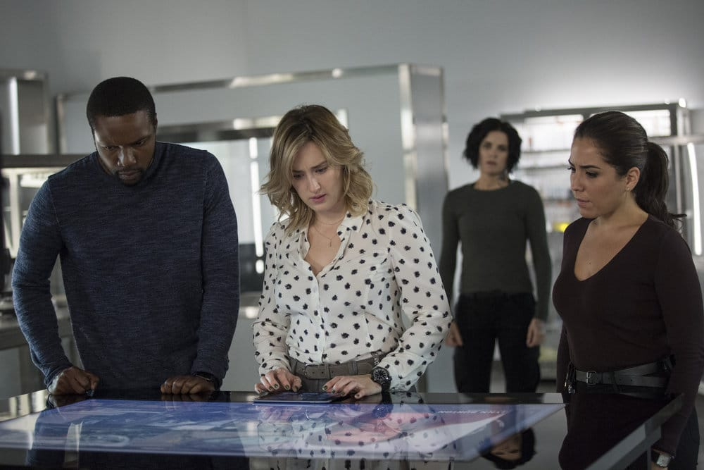 """BLINDSPOT -- """"Do Not Slack, the Featherweight Wins"""" Episode 208 -- Pictured: (l-r) Rob Brown as Edgar Reade, Ashley Johnson as Patterson, Jaimie Alexander as Jane Doe, Audrey Esparza as Tasha Zapata -- (Photo by: Eric Liebowitz/Warner Bros/NBC)"""