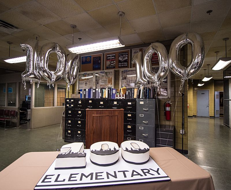 """Henny Penny The Sky Is Falling"" -- The cast of ELEMENTARY celebrates their milestone 100th episode with a cake-cutting ceremony Pictured (L-R) Photo: Michele Crowe /CBS ©2016 CBS Broadcasting Inc. All Rights Reserved."
