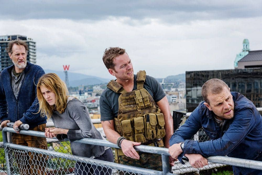 "VAN HELSING -- ""For Me"" Episode 107 -- Pictured: (l-r) Christopher Heyerdahl as Sam, Alison Wazendura as Nicole, Jonathan Scarfe as Axel Miller, David Cubitt as John -- (Photo by: Dan Power/Helsing S1 Productions/Syfy)"