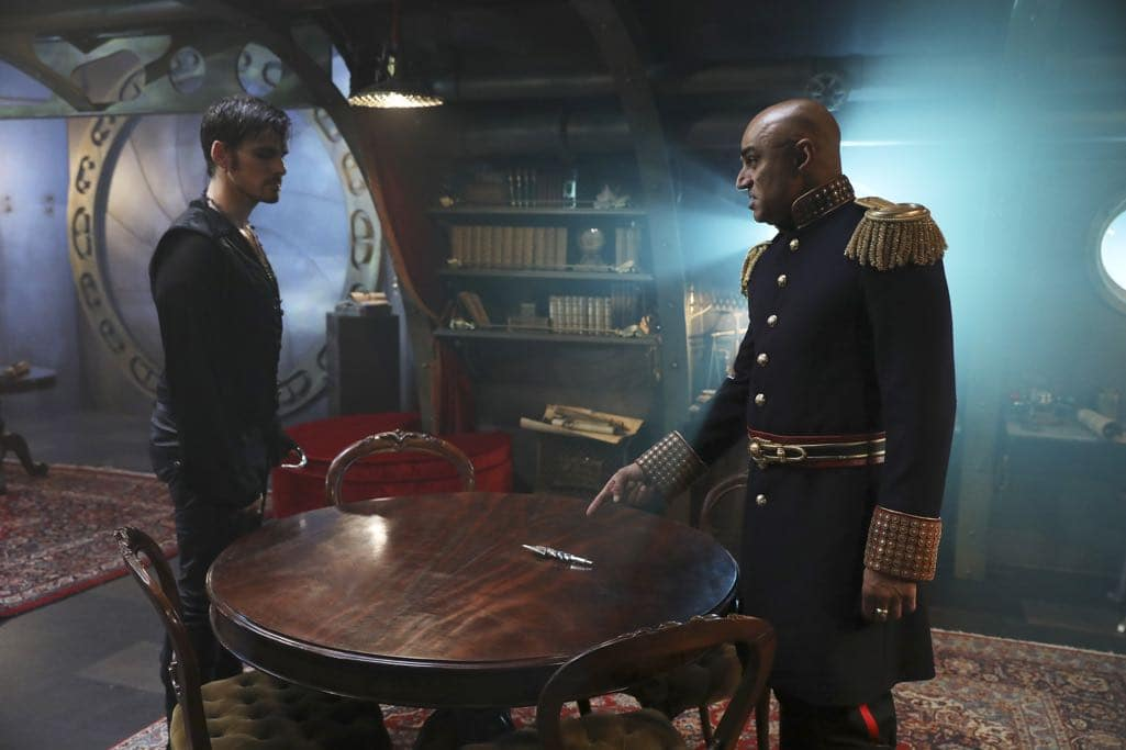"""ONCE UPON A TIME - """"Dark Waters"""" - Emma tries to convince Aladdin to work with Jasmine to help Agrabah, while Regina teams up with Snow and David to free Archie from Zelena. The Evil Queen sows suspicion between Henry and Hook, even as Mr. Gold reminds her of his most important lesson. Meanwhile, in the past, Hook finds himself kidnapped by the mysterious Captain Nemo and held captive inside his legendary submarine, the Nautilus, on """"Once Upon a Time,"""" SUNDAY, OCTOBER 30 (8:00-9:00 p.m. EDT), on the ABC Television Network. (ABC/Jack Rowand) COLIN O'DONOGHUE, FARAN TAHIR"""
