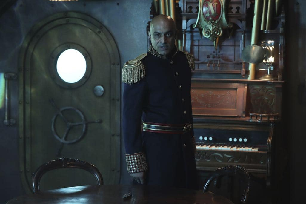 """ONCE UPON A TIME - """"Dark Waters"""" - Emma tries to convince Aladdin to work with Jasmine to help Agrabah, while Regina teams up with Snow and David to free Archie from Zelena. The Evil Queen sows suspicion between Henry and Hook, even as Mr. Gold reminds her of his most important lesson. Meanwhile, in the past, Hook finds himself kidnapped by the mysterious Captain Nemo and held captive inside his legendary submarine, the Nautilus, on """"Once Upon a Time,"""" SUNDAY, OCTOBER 30 (8:00-9:00 p.m. EDT), on the ABC Television Network. (ABC/Jack Rowand) FARAN TAHIR"""