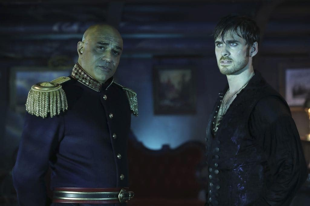 """ONCE UPON A TIME - """"Dark Waters"""" - Emma tries to convince Aladdin to work with Jasmine to help Agrabah, while Regina teams up with Snow and David to free Archie from Zelena. The Evil Queen sows suspicion between Henry and Hook, even as Mr. Gold reminds her of his most important lesson. Meanwhile, in the past, Hook finds himself kidnapped by the mysterious Captain Nemo and held captive inside his legendary submarine, the Nautilus, on """"Once Upon a Time,"""" SUNDAY, OCTOBER 30 (8:00-9:00 p.m. EDT), on the ABC Television Network. (ABC/Jack Rowand) FARAN TAHIR, COLIN O'DONOGHUE"""