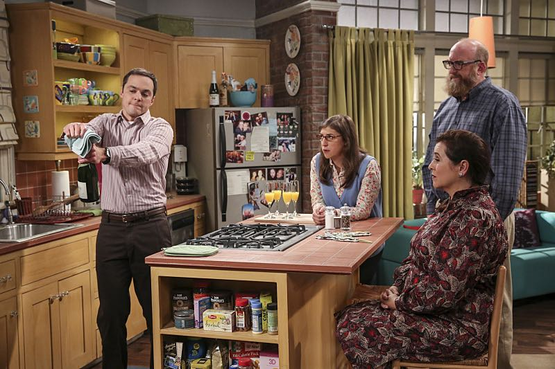 """The Fetal Kick Catalyst"" -- Pictured: Sheldon Cooper (Jim Parsons), Amy Farrah Fowler (Mayim Bialik), Mrs. Petrescu (Michelle Arthur) and Bert (Brian Posehn). Penny is surprised to learn she has fans of her performance in ""Serial Ape-ist"" when she attends Van Nuys Comic Con with Leonard. Also, Amy hosts a Sheldon-style brunch at Penny's apartment and Wolowitz makes an impulsive purchase when he starts stressing out about the baby on the way, when THE BIG BANG THEORY moves to its regular time period, Thursday, Oct. 27 (8:00-8:31 PM, ET/PT), on the CBS Television Network. Photo: Michael Yarish/Warner Bros. Entertainment Inc. © 2016 WBEI. All rights reserved."