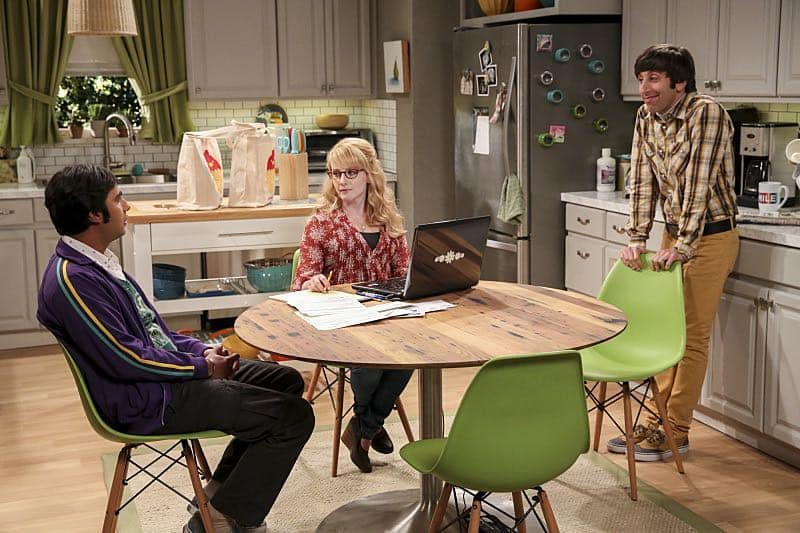 """The Fetal Kick Catalyst"" -- Pictured: Rajesh Koothrappali (Kunal Nayyar), Bernadette (Melissa Rauch) and Howard Wolowitz (Simon Helberg). Penny is surprised to learn she has fans of her performance in ""Serial Ape-ist"" when she attends Van Nuys Comic Con with Leonard. Also, Amy hosts a Sheldon-style brunch at Penny's apartment and Wolowitz makes an impulsive purchase when he starts stressing out about the baby on the way, when THE BIG BANG THEORY moves to its regular time period, Thursday, Oct. 27 (8:00-8:31 PM, ET/PT), on the CBS Television Network. Photo: Michael Yarish/Warner Bros. Entertainment Inc. © 2016 WBEI. All rights reserved."