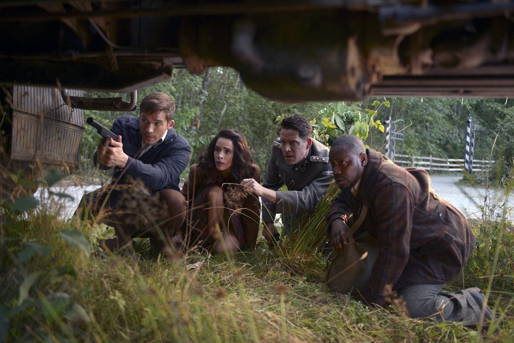 "TIMELESS -- ""Party At Castle Varlar"" Episode 103 -- Pictured: (l-r) Matt Lanter as Wyatt Logan, Abigail Spencer as Lucy Preston, Sean Maguire as Ian Fleming, Malcolm Barrett as Rufus Carlin -- (Photo by: Sergei Bachlakov/NBC)"
