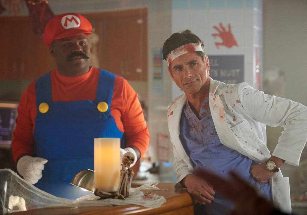 """SCREAM QUEENS: L-R: James Earl and John Stamos in the all-new """"Halloween Blues"""" episode of SCREAM QUEENS airing Tuesday, Oct. 18 (9:01-10:00 PM ET/PT) on FOX. Cr: Michael Becker / FOX. © 2016 FOX Broadcasting Co."""