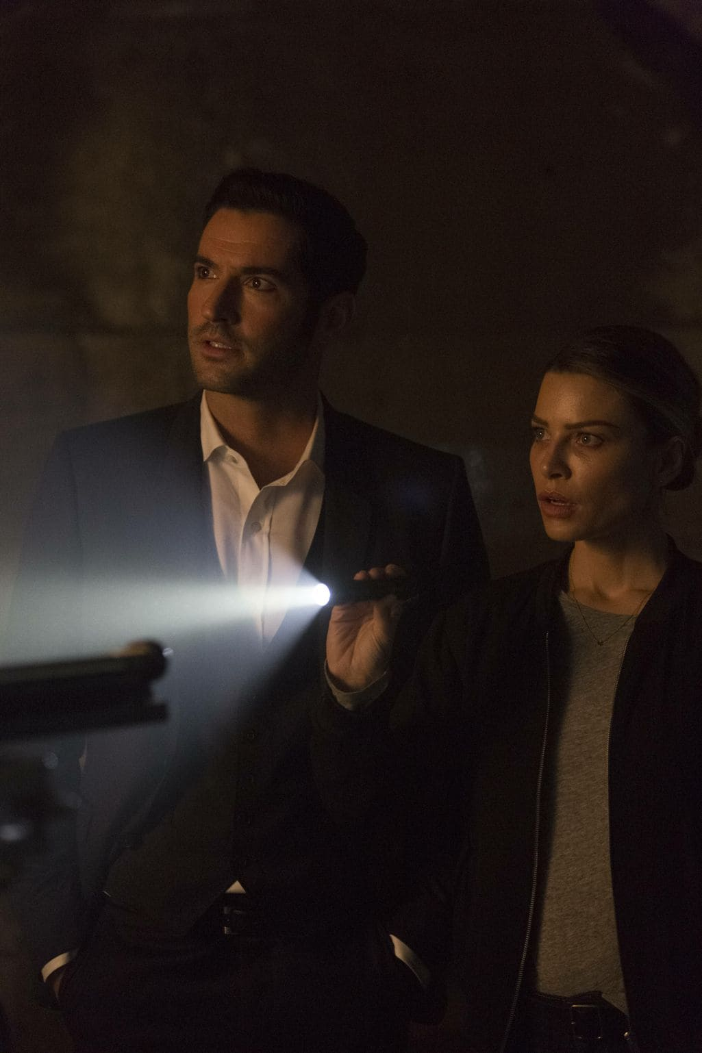 "LUCIFER: L-R: Tom Ellis and Lauren German in the ""Sin-Eater"" episode of LUCIFER airing Monday, Oct. 10 (9:01-10:00 PM ET/PT) on FOX. ©2016 Fox Broadcasting Co. Cr: Michael Courtney/FOX."