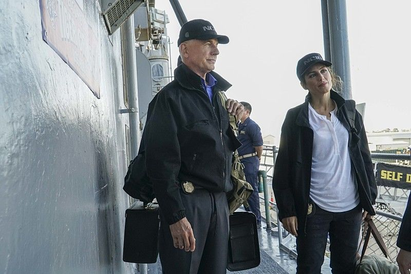 """""""Love Boat"""" -- After the body of a navy lieutenant is discovered aboard a destroyer during a tiger cruise, when civilian guests are allowed to spend the night on the ship, Gibbs, Quinn and Palmer travel out to sea to investigate. Also, McGee contemplates the perfect proposal for Delilah Fielding (Margo Harshman), on NCIS, Tuesday, Oct. 11 (8:00-9:00 PM, ET/PT), on the CBS Television Network. Pictured: Mark Harmon, Jennifer Esposito.. Photo: Bill Inoshita/CBS ©2016 CBS Broadcasting, Inc. All Rights Reserved"""