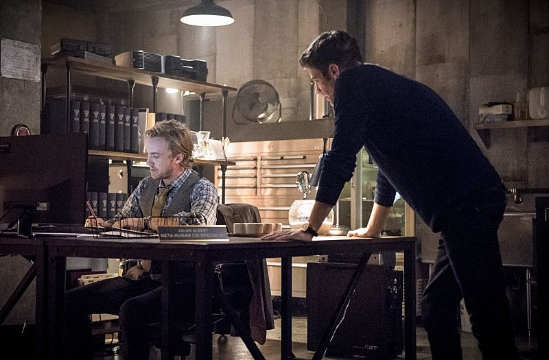 """The Flash -- """"Paradox"""" -- Image: FLA302b_0155b.jpg -- Pictured: Tom Felton as Julian Albert and Grant Gustin as Barry Allen -- Photo: Dean Buscher/The CW -- © 2016 The CW Network, LLC. All rights reserved."""