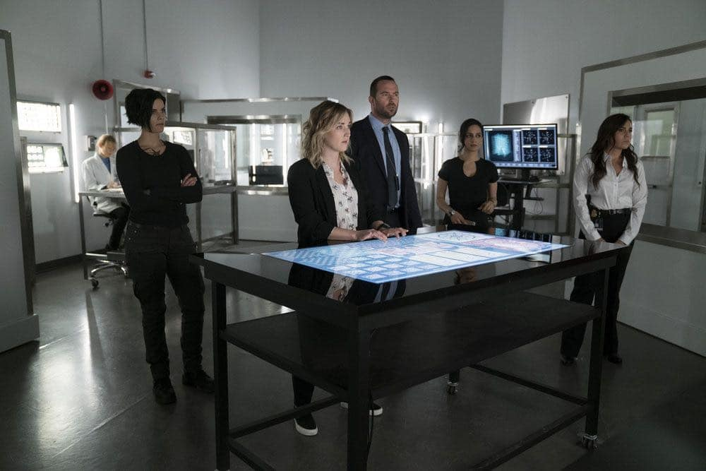 "BLINDSPOT -- ""Condone Untidiest Thefts"" Episode 205 -- Pictured: (l-r) Jaimie Alexander as Jane Doe, Ashley Johnson as Patterson, Sullivan Stapleton as Kurt Weller, Archie Panjabi as Nas Kamal, Audrey Esparza as Tasha Zapata -- (Photo by: Peter Kramer/NBC)"