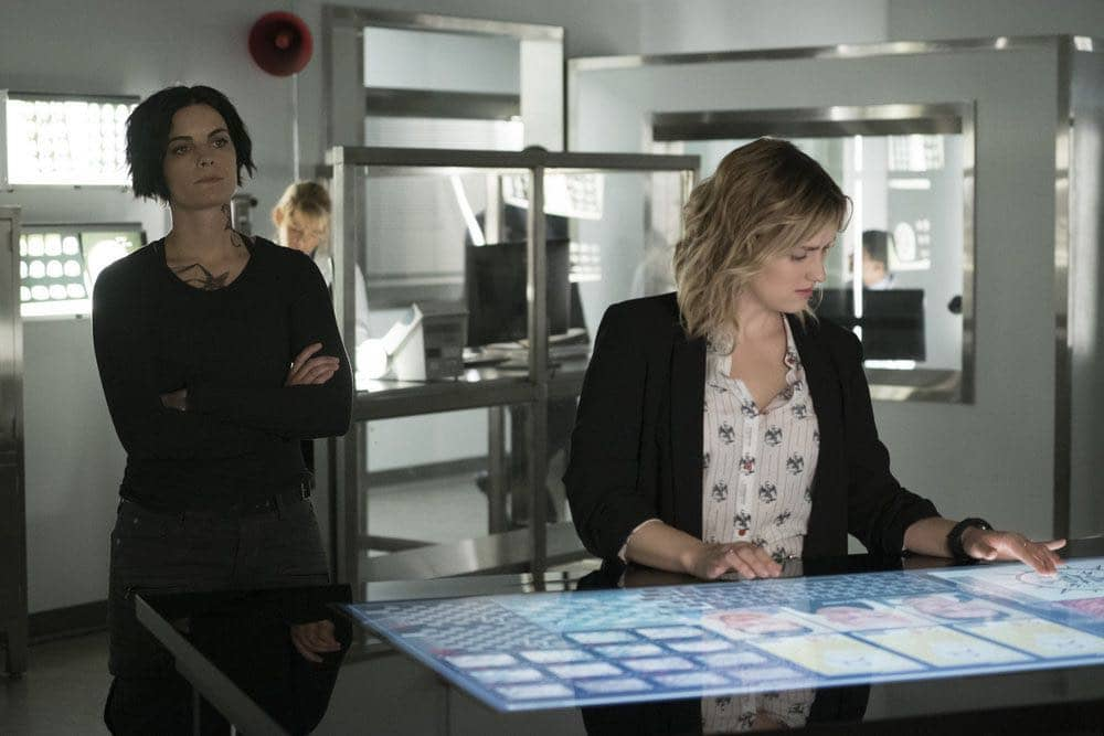 "BLINDSPOT -- ""Condone Untidiest Thefts"" Episode 205 -- Pictured: (l-r) Jaimie Alexander as Jane Doe, Ashley Johnson as Patterson -- (Photo by: Peter Kramer/NBC)"