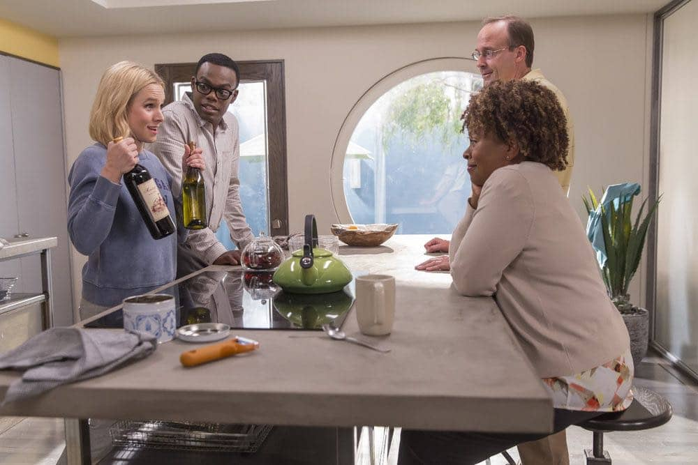 "THE GOOD PLACE -- ""Category 55 Emergency Doomsday Crisis"" Episode 109 -- Pictured: (l-r) Kristen Bell as Eleanor, William Jackson Harper as Chidi, John Hartmann as Bart, Monnae Michaell as Nina -- (Photo by: Ron Batzdorff/NBC)"