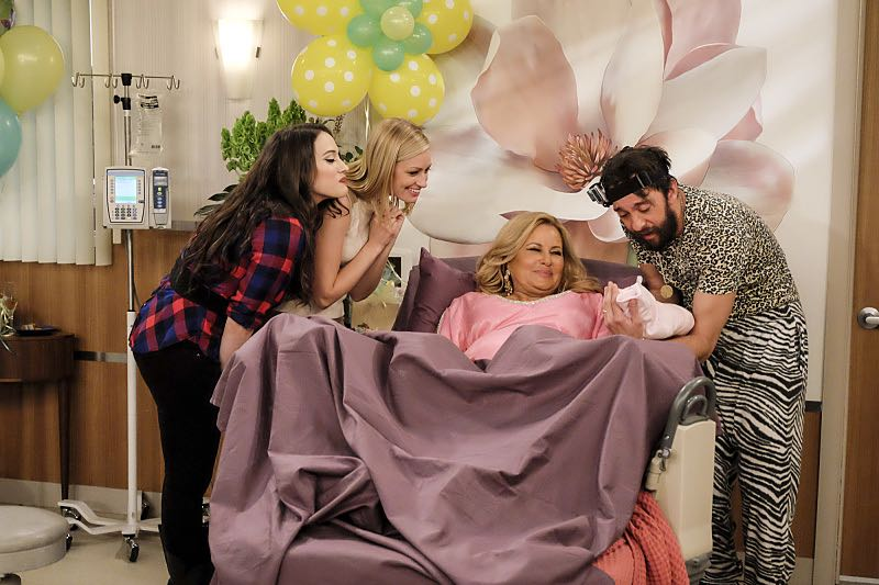 """""""And The Two Openings: Part Two"""" -- Pictured: Caroline Channing (Beth Behrs), Caroline Channing (Beth Behrs), Sophie (Jennifer Coolidge) and Oleg (Jonathan Kite). When Sophie goes into labor just before the Dessert Bar's grand opening, she demands that Max and Caroline be present for the birth. Also, the girls run into problems when they don't secure a liquor license for their new venue, on the sixth season premiere of 2 BROKE GIRLS, Monday, Oct. 10 (9:30-10:00 PM, ET/PT) on the CBS Television Network. Photo: Darren Michaels/Warner Bros. Entertainment Inc. © 2016 WBEI. All rights reserved."""