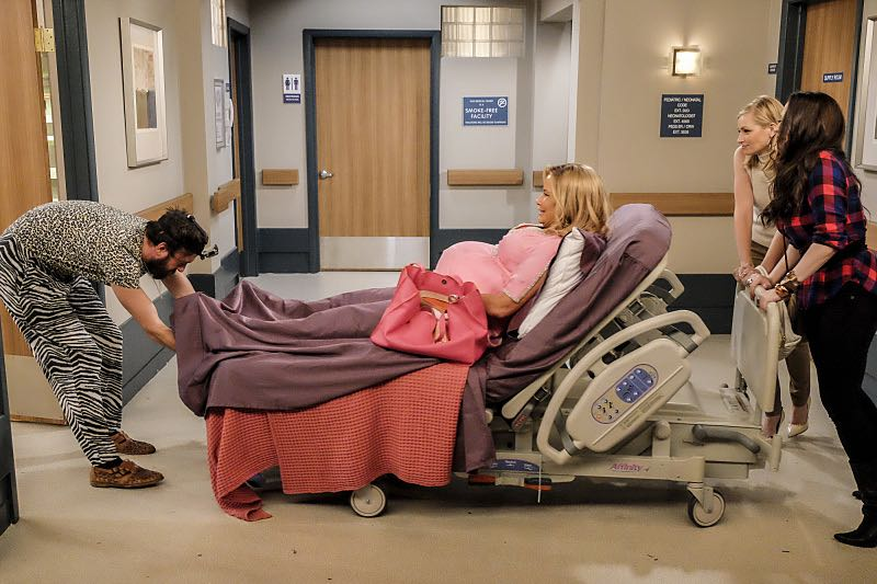"""""""And The Two Openings: Part Two"""" -- Pictured: Oleg (Jonathan Kite), Sophie (Jennifer Coolidge), Caroline Channing (Beth Behrs) and Max Black (Kat Dennings). When Sophie goes into labor just before the Dessert Bar's grand opening, she demands that Max and Caroline be present for the birth. Also, the girls run into problems when they don't secure a liquor license for their new venue, on the sixth season premiere of 2 BROKE GIRLS, Monday, Oct. 10 (9:30-10:00 PM, ET/PT) on the CBS Television Network. Photo: Darren Michaels/Warner Bros. Entertainment Inc. © 2016 WBEI. All rights reserved."""
