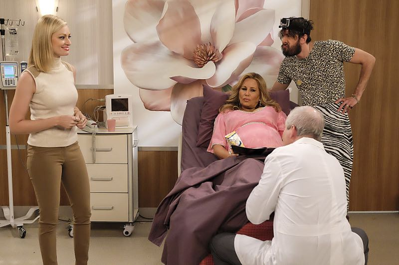"""""""And The Two Openings: Part Two"""" -- Pictured: Caroline Channing (Beth Behrs), Sophie (Jennifer Coolidge) and Oleg (Jonathan Kite). When Sophie goes into labor just before the Dessert Bar's grand opening, she demands that Max and Caroline be present for the birth. Also, the girls run into problems when they don't secure a liquor license for their new venue, on the sixth season premiere of 2 BROKE GIRLS, Monday, Oct. 10 (9:30-10:00 PM, ET/PT) on the CBS Television Network. Photo: Darren Michaels/Warner Bros. Entertainment Inc. © 2016 WBEI. All rights reserved."""