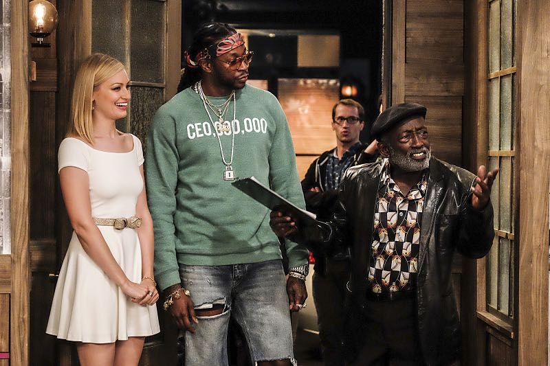 """""""And The Two Openings: Part Two"""" -- Pictured: Caroline Channing (Beth Behrs), 2 Chainz and Earl (Garrett Morris). When Sophie goes into labor just before the Dessert Bar's grand opening, she demands that Max and Caroline be present for the birth. Also, the girls run into problems when they don't secure a liquor license for their new venue, on the sixth season premiere of 2 BROKE GIRLS, Monday, Oct. 10 (9:30-10:00 PM, ET/PT) on the CBS Television Network. Photo: Darren Michaels/Warner Bros. Entertainment Inc. © 2016 WBEI. All rights reserved."""