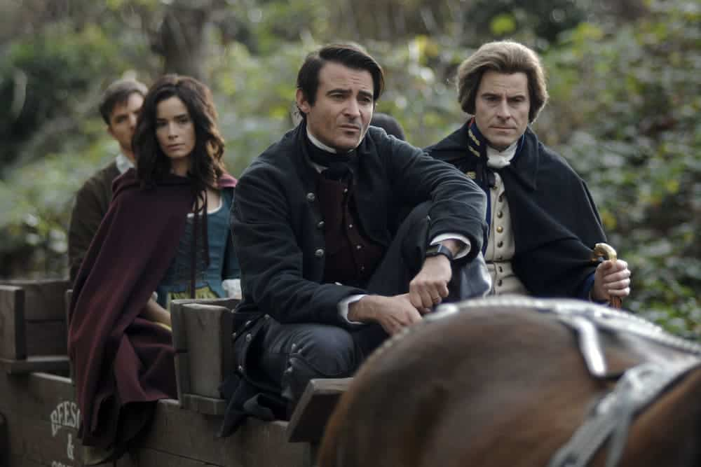 "TIMELESS -- ""The Capture of Benedict Arnold"" Episode 109 -- Pictured: (l-r) Abigail Spencer as Lucy Preston, Goran Visnjic as Garcia Flynn, Damian O'Hare as George Washington -- (Photo by: Sergei Bachlakov/NBC)"