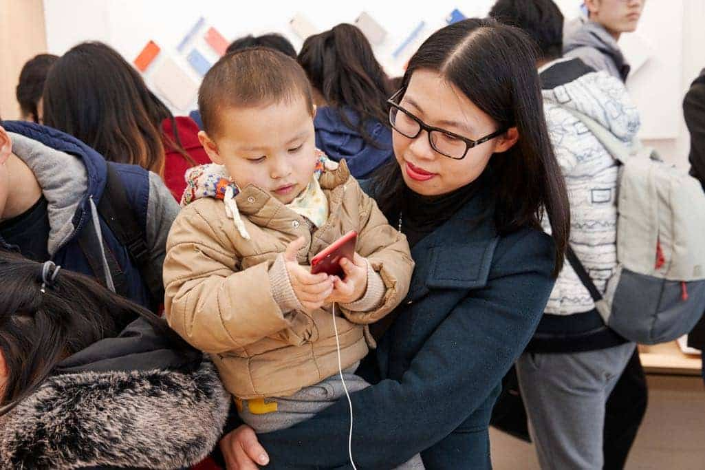 Customers in Nanjing explore Apple's latest products at Apple Nanjing Jinmao Place.