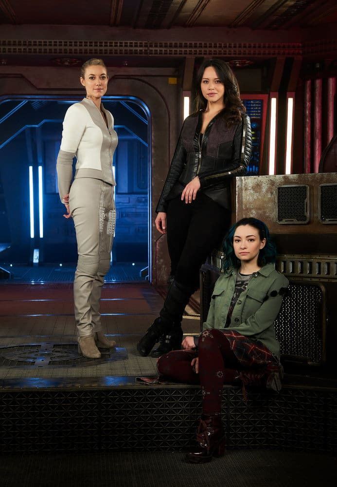DARK MATTER -- Season:3 -- Pictured: (l-r) Zoie Palmer as The Android, Melissa O'Neil as Two, Jodelle Ferland as Five