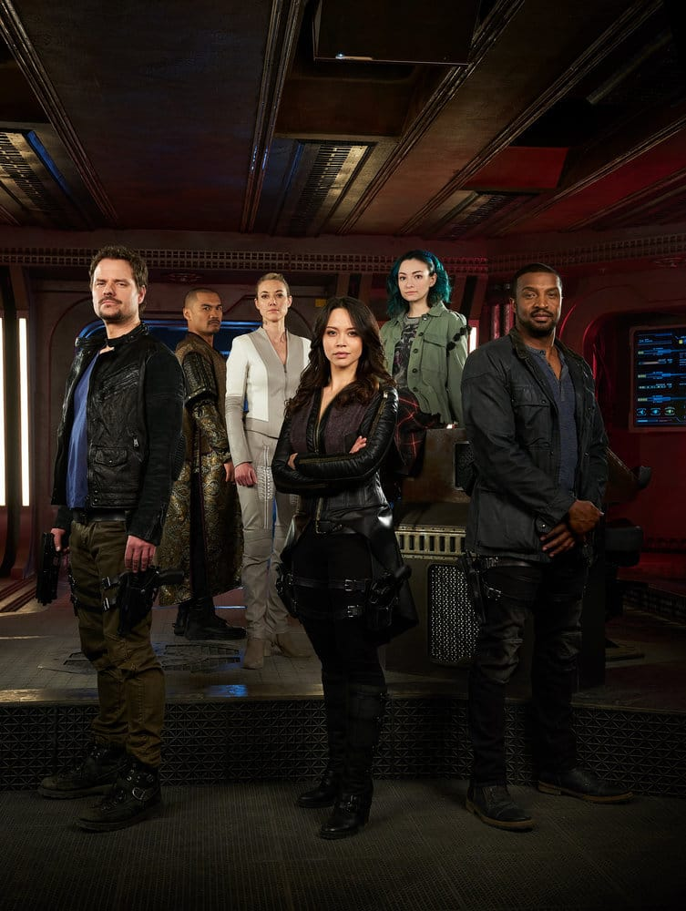 DARK MATTER -- Season:3 -- Pictured: (l-r) Anthony Lemke as Three, Alex Mallari Jr. as Four, Zoie Palmer as The Android, Melissa O'Neil as Two, Jodelle Ferland as Five, Roger Cross as Six