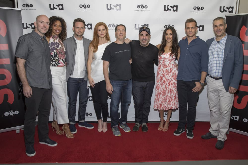 SUITS -- Script Reading Presented by USA Network -- Pictured: (l-r) Gene Klein, Gina Torres, Patrick J. Adams, Sarah Rafferty, Aaron Korsh, Rick Hoffman, Meghan Markle, Gabriel Macht, David Bartis -- (Photo by: Rick Kern/USA Network)