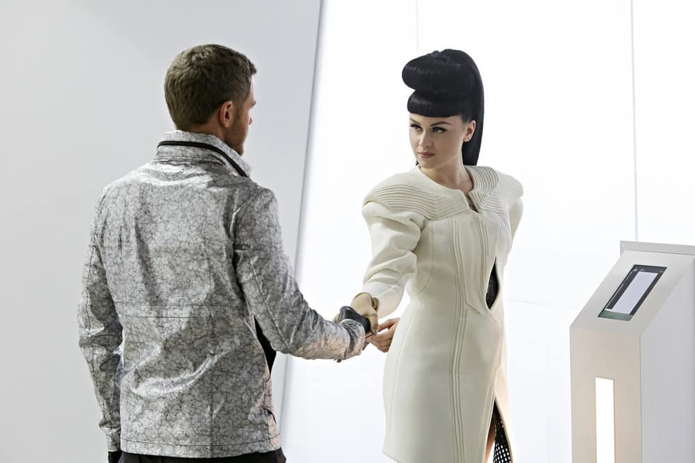 "KILLJOYS -- ""A Skinner, Darkley"" Episode 302 -- Pictured: (l-r) Aaron Ashmore as John, Viktoria Modesta as Niko"