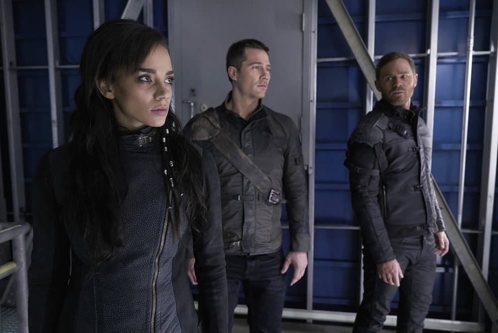 "KILLJOYS -- ""The Hullen Have Eyes"" Episode 303 -- Pictured: (l-r) Hannah John-Kamen as Dutch, Luke Macfarlane as D'Avin, Aaron Ashmore as John -- (Photo by: Steve Wilkie/Killjoys III Productions Limited/Syfy)"