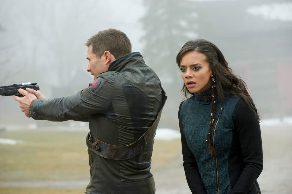 "KILLJOYS -- ""The Hullen Have Eyes"" Episode 303 -- Pictured: (l-r) Luke Macfarlane as D'Avin, Hannah John-Kamen as Dutch -- (Photo by: Steve Wilkie/Killjoys III Productions Limited/Syfy)"