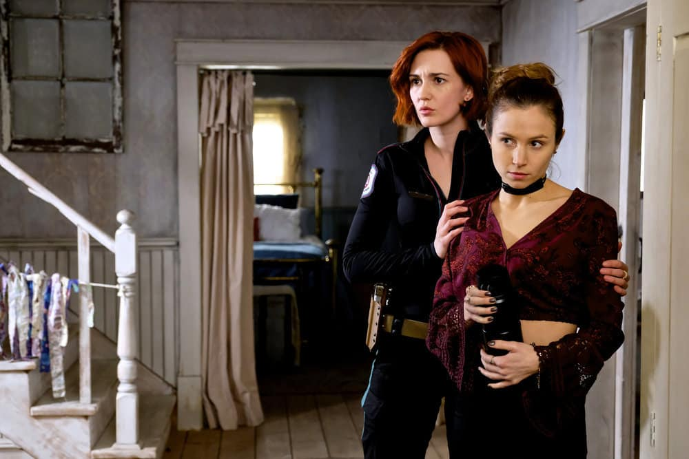 """WYNONNA EARP -- """"Whiskey Lullaby"""" Episode 206 -- Pictured: (l-r) Katherine Barrell as Officer Nicole Haught, Domonique Provost-Chalkley as Waverly Earp -- (Photo by: Michelle Faye/Syfy/Wynonna Earp Season 2)"""